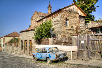 old car by a house in Sighnaghi, Georgia