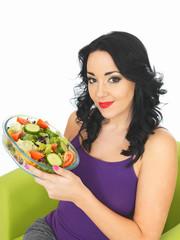 Young Woman Eating a Fresh Crisp Mixed Garden Salad