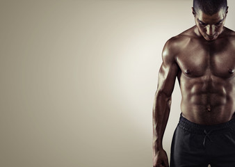 Sport. Close up image of muscular african male in sports clothing
