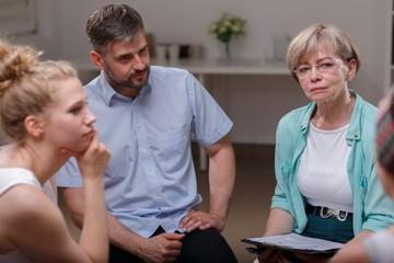 Psychologist listening member of group
