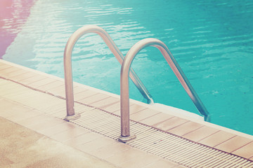 Swimming pool and stairs with vintage effect.
