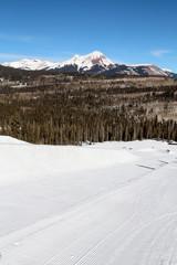 Diagonal empty half pipe with snow covered peak