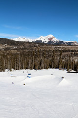 Many rails at a terrain park with Engineer mountain