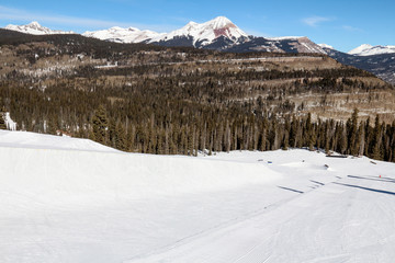 View down a half pipe and Engineer mountain