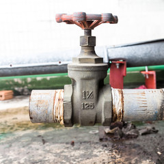 Old valve mounted on rooftop industry building