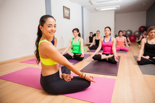 Happy yoga instructor in class