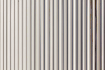 The corrugated grey metal wall background.