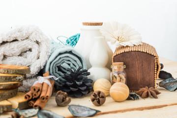 spa stuff, cinnamonand flower with towel on wood