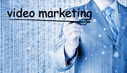business man writing Video Marketing