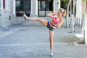 A pretty woman kicking in the air