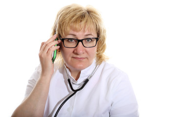 doctor with stethoscope speaks on the phone