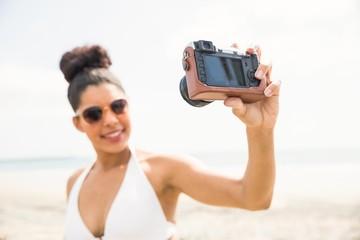 Pretty woman in bikini taking selfie