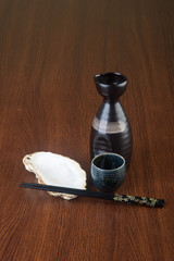 japanese cuisine. sake on the background