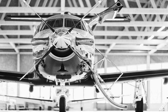 Single turboprop aircraft Pilatus PC-12 in hangar. Stans, Switzerland, 29th November 2010.