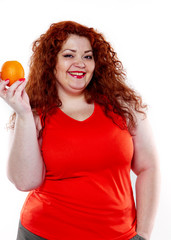 the fat woman with orange juice vegetable fruit holding isolated on the white background