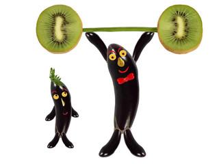 Creative food concept. Funny eggplant raises the bar of kiwi.