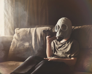 Boy Wearing Gas Mask for Clean Air in Home