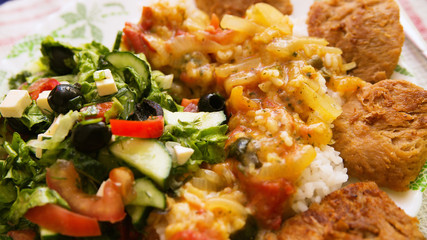 Vegetable salad, rice and meat
