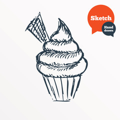 Hand drawn cupcake. Sketched muffin symbol.
