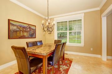 Elegant dinning room with simple chandelier.