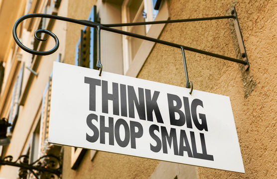 Think Big Shop Small sign in a conceptual image