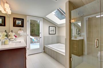 Luxury master bathroom with white tile floor.