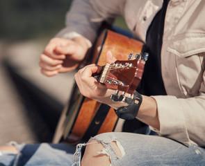 Man hands with guitar close up image