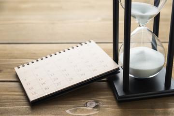 Hourglass and calendar.