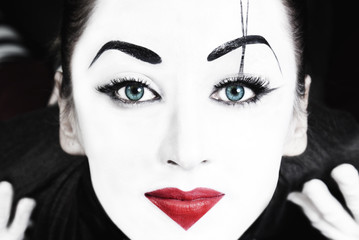 beautiful woman mime with blue eyes