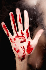 Human hand with blood