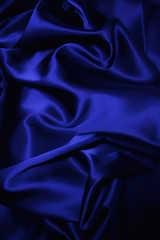 texture of a dark blue silk