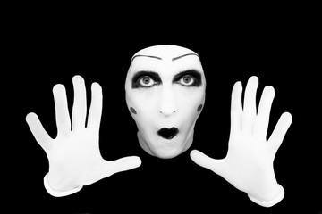 Portrait of the mime in white gloves