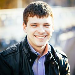 Handsome man outdoors portrait. Autumn colors.