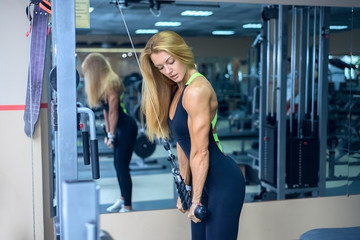 beautiful woman hand trains in the gym