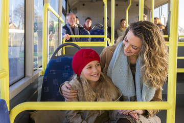 Mother and daughter on the bus