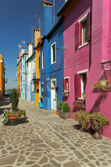 Houses with colorful facades are standing in a row