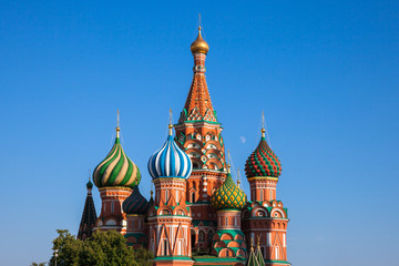 Close-up view of the famous Saint Basil's Cathedral with moon rising between its domes, Red Square, Moscow, Russia.