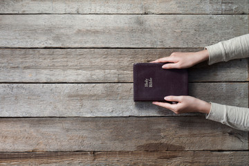christian woman holding the bible. top angle of view