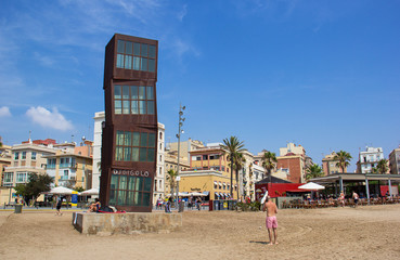 The sculpture designed by installation artist Rebecca Horn in COR-TEN at  Barceloneta Beach