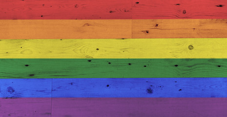 gay pride rainbow flag pattern on wooden surface