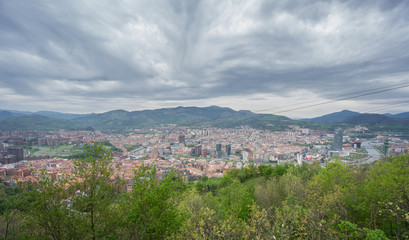 Bilbao and Pagasarri skyline from Artxanda mountain, stormy day