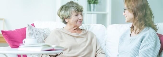 Carer talking with pensioner
