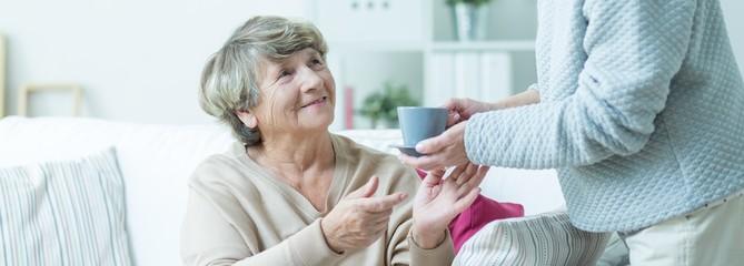 Helping elder lady
