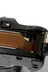 Camera film loading. Vintage retro camera with a strip of film loaded.