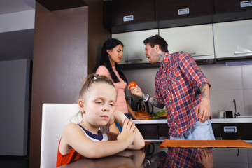 parents arguing in the kitchen, a little girl crying.