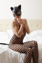 Model advertises catwoman costume in hotel room