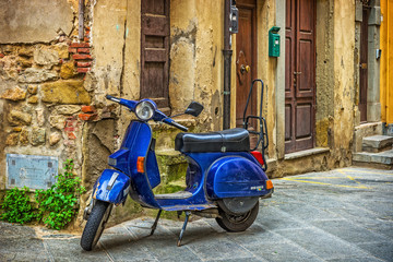 Scooter in the street in the old town of Tuscany