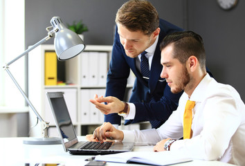 Two confident businessmen networking in office