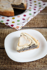 Slice of homemade poppy seed pie with pastry hearts