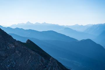 Blue toned mountain silhouette at sunrise